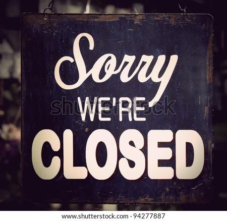 Vintage metal closed sign on shop door - stock photo