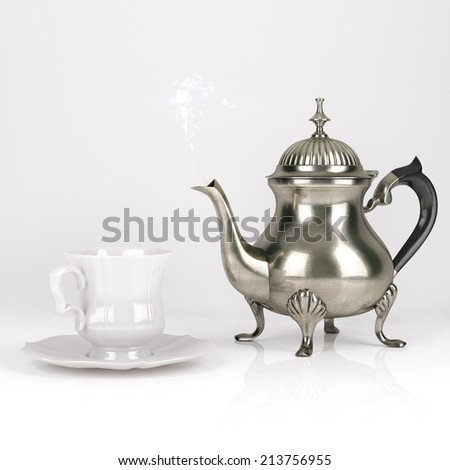 Vintage Metal Coffee Pot With Cute White Cup On White Background - stock photo