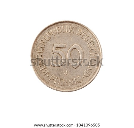 vintage metal coin on white background