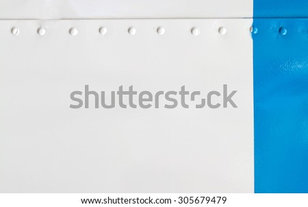 Vintage metal covering. White and blue paint skin with rivet. copy space. Soft focus. - stock photo