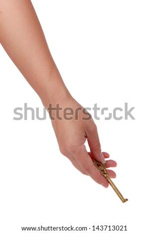 Vintage metal key in a female hand - stock photo