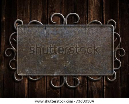 Vintage metal plate  on old oak door - stock photo