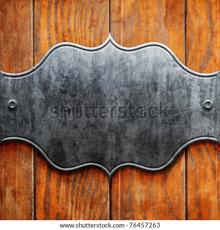 Vintage metal signboard on old wooden planks - stock photo