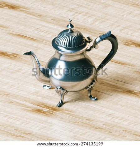 Vintage metallic coffee kettle on wooden panel background . - stock photo