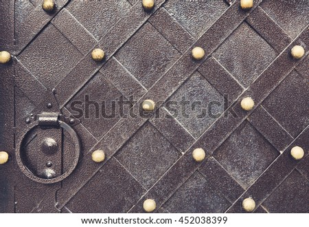 Vintage metallic pattern of medieval gate. Decorative grunge checkered iron structure background. Architectural detail - stock photo