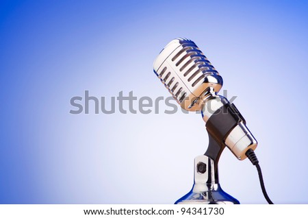 Vintage microphone against the background - stock photo