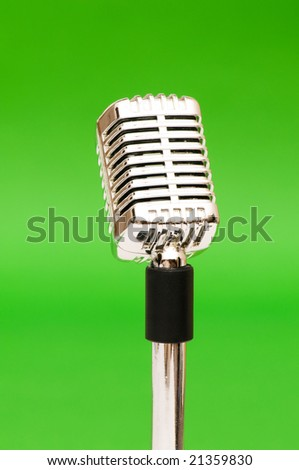 Vintage microphone against the bright green background