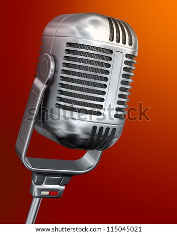 Vintage microphone against the orange background - stock photo
