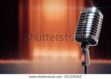 Vintage microphone at stage background - stock photo