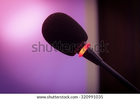 vintage microphone in a meeting room and warm light. - stock photo