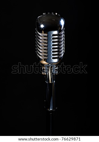 Vintage microphone isolated on black background - stock photo
