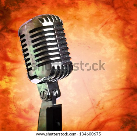 Vintage microphone on distressed grunge background - stock photo