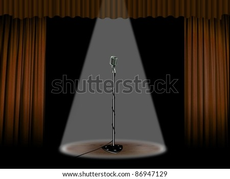 Vintage microphone on stage - stock photo