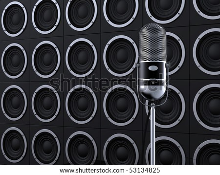 Vintage microphone on stage with loudspeakers in background - stock photo