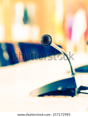 Vintage Microphone on the table in the conference room. - stock photo
