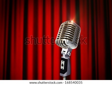 Vintage Microphone over Red Curtains - stock photo