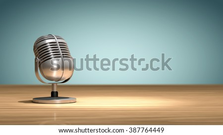 Vintage microphone placed on a wooden table and oriented to record the sound - stock photo
