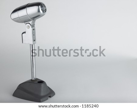 Vintage microphone with room for text - stock photo