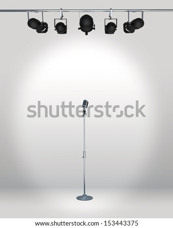 vintage microphone with spotlight - stock photo
