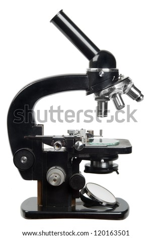 Vintage microscope isolated on white - stock photo