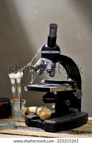 Vintage microscope on table  - stock photo