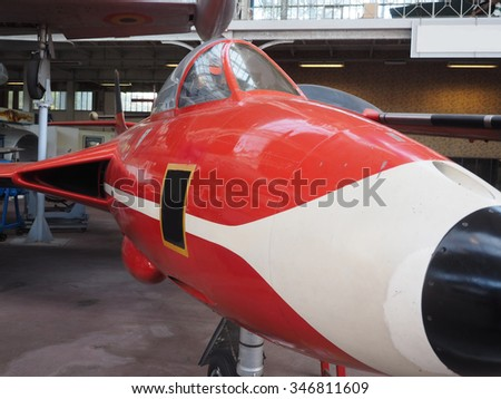 vintage military Belgian fighter jet airplane on display at Royal Museum of the Armed Forces and Military History in