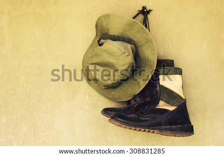 vintage,military caps and military boots - stock photo