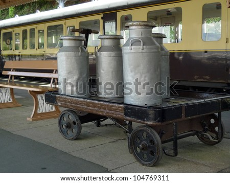 Vintage milk churns on railway platform - stock photo