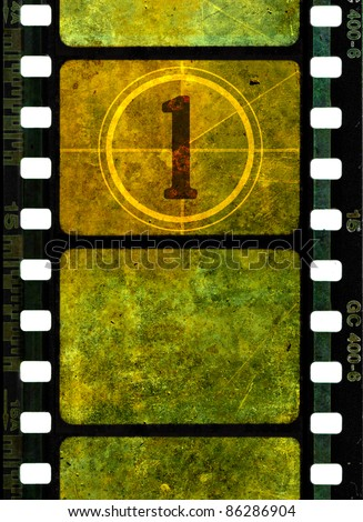 Vintage 35 mm film reel, colorful grunge textured film frames and a number one in countdown - stock photo