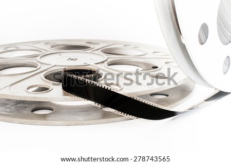 Vintage 35 mm movie cinema reel on white background film unrolled - stock photo