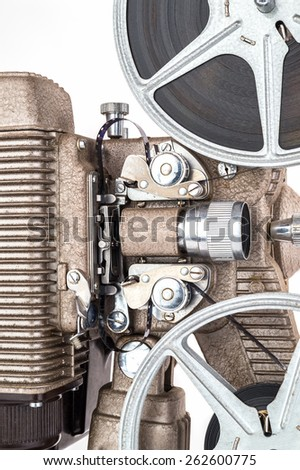 Vintage 8 mm Movie Projector with Film. - stock photo