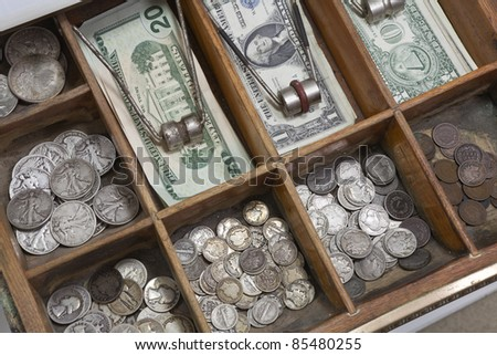 Vintage money drawer with old US coins from the 1930's. - stock photo