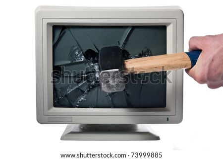 vintage monitor is smashed with a hammer