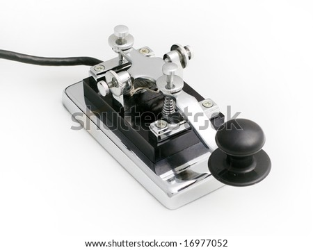 vintage morse telegraph key with white background - stock photo