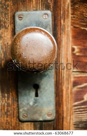 Vintage mortise lockset, with round door handle, and key hole. - stock photo