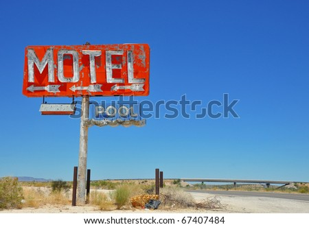 Vintage motel sign on a US interstate. - stock photo