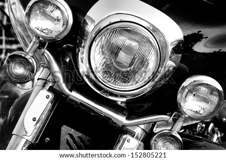 Vintage motorbike. Retro motorcycle with headlights on black and white colors. - stock photo