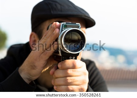 Vintage movie camera shooting a love in a park - stock photo