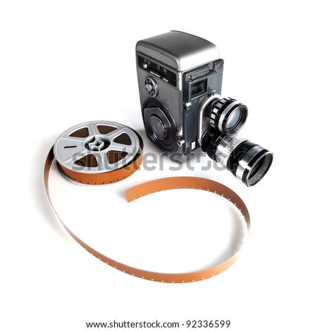 Vintage movie camera with a reel of film - stock photo