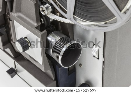 Vintage movie projector with film reel spooled. - stock photo