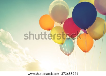 Vintage multicolor balloons of birthday party. Instagram retro filter effect - stock photo