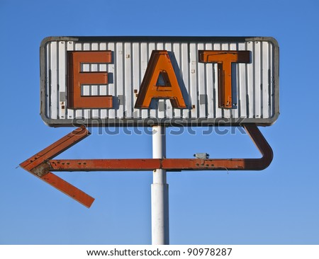 Vintage neon eat sign ruin in early morning light. - stock photo