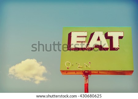 vintage neon restaurant sign. Instagram toned  - stock photo