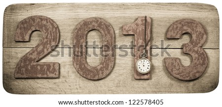 Vintage New Year 2013 date and pocket watch on wooden board background - stock photo