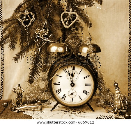Vintage New Year still life in sepia tone - stock photo