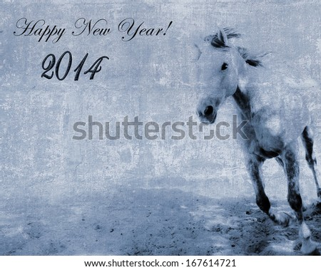 Vintage New Year 2014 textured postcard with a running horse - stock photo