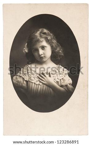 vintage nostalgic portrait of little girl ca. 1920 - stock photo