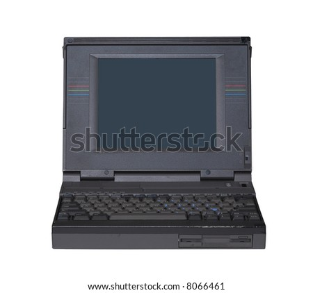 Vintage notebook computer - opened - stock photo