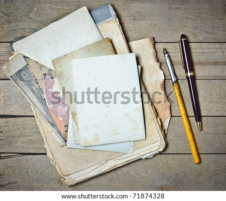 vintage notebook old papers and pens on a wooden table - stock photo