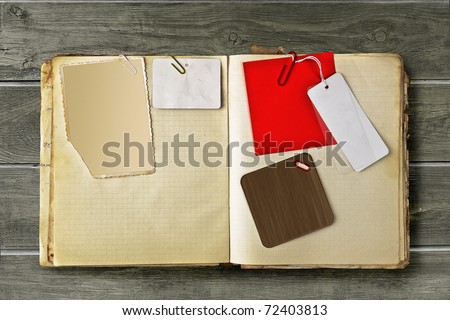 Vintage notebook with stained pages retro photo frame and labels - stock photo